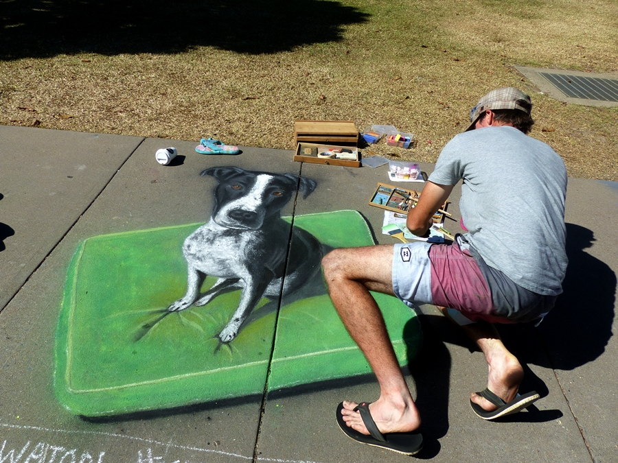A man and his chalk dog